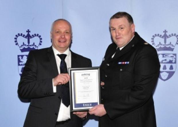DEDICATED: PC Rob Piper, left, receiving his commendation from Supt Kevin Purcell.