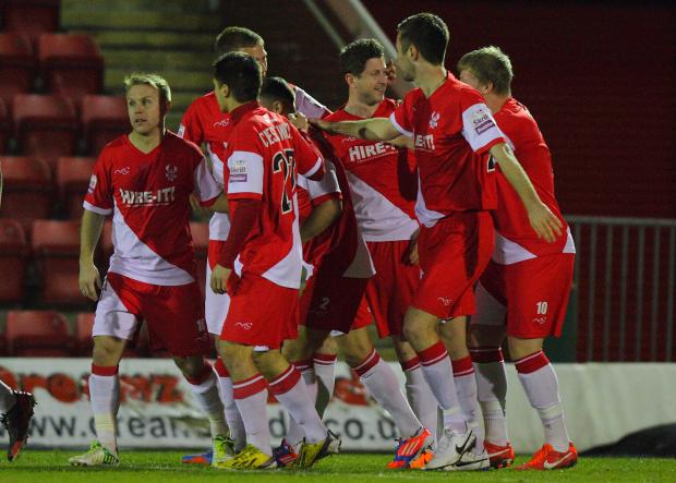 Harriers players surround Callum Gittings after he fired Harriers ahead in spectacular fashion. Picture: ADRIAN HOSKINS