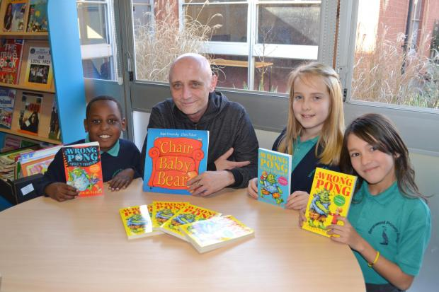 INSPIRING PUPILS: From left, Giorgio Malara, seven, illustrator Chris Fisher, Millie O'Neil, 11, and Amy Kenyon, nine.