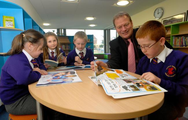 NEW LOOK: Headteacher Martin de Vine with year seven pupils, from left, Lottie Davies, Amy Wright, Alex Reeve and Jamie Griffin in the refurbished library. Picture: 121407L