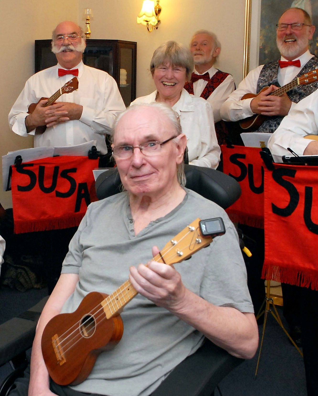 IN TUNE: Members of Kidderminster Ukuele Club playing for founder Ray Shakeshaft in the nursing home where he lives.