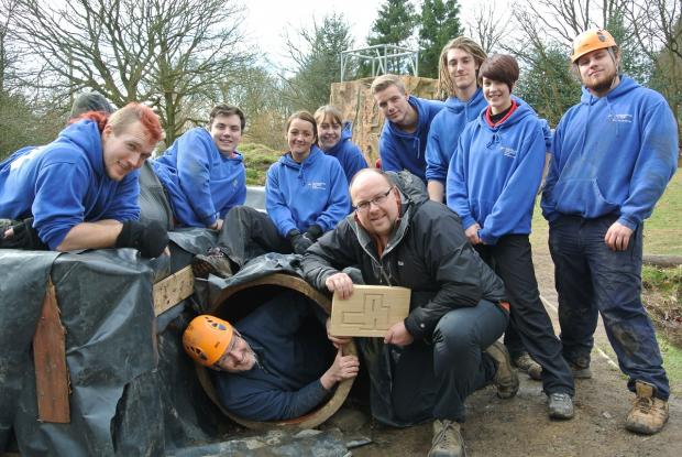 TUNNEL VISION: Andy Dobson, inside one of the tunnels, with students who created the caving system.