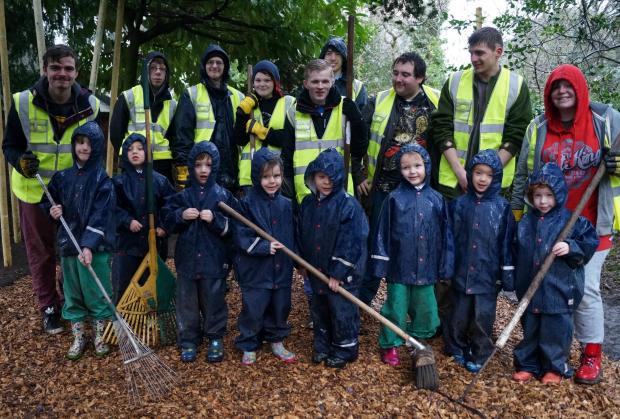 IN THE GARDEN: Holy Trinity Pupils, front, thank students from Worcester College of Technology for the work done in the woodland play area.