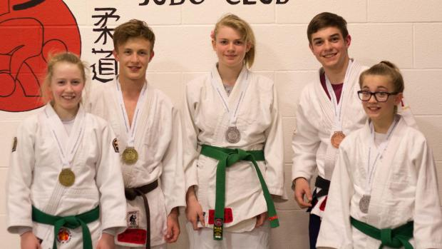 Kidderminster Shuttle: Teaching lessons: Sian Bobrowska, Rory Gulliver, Hetty Tinsdale Brendan Crummy and Leah Grosvenor with their medals from the British School Championships.