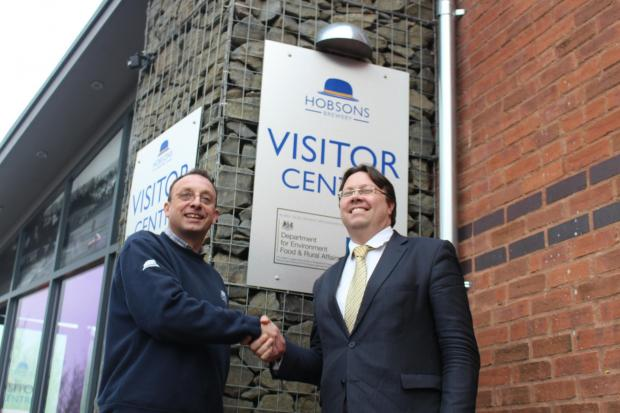 MAKING  A TOAST: Nick Davis, owner of Hobsons Brewery and rural affairs minister Dan Rogerson outside the new visitor centre.