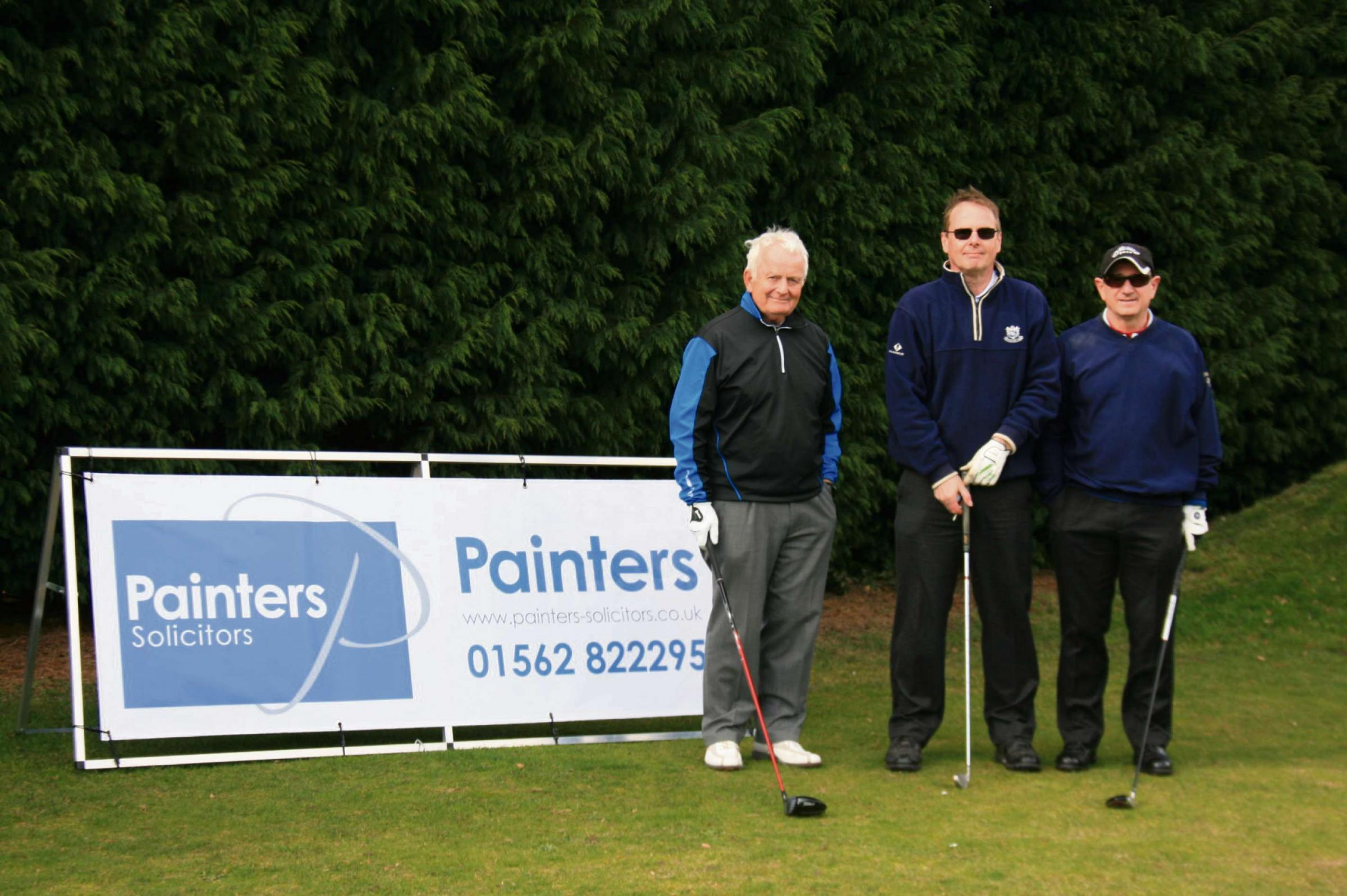 TEEING OFF: From left,  winners Nick Thomas, Peter Simmonds and John Lambert from ER Grove and Co.