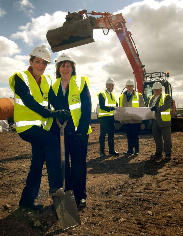 Kidderminster Shuttle: UNDER CONSTRUCTION: From left, Kathryn Medlicott, Debbie Howard and Steve Winfield of Tesco, Mitton ward councillor Chris Rogers and pr