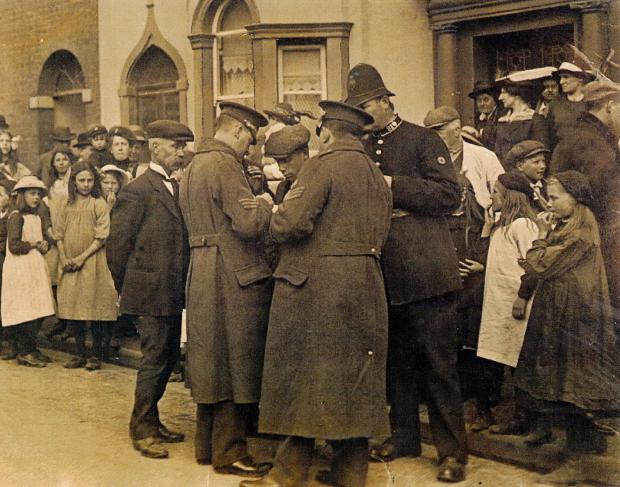 Kidderminster Shuttle: SIGNING UP: Recruitment taking place in front of Tudor House in Chaddesley Corbett in 1914.