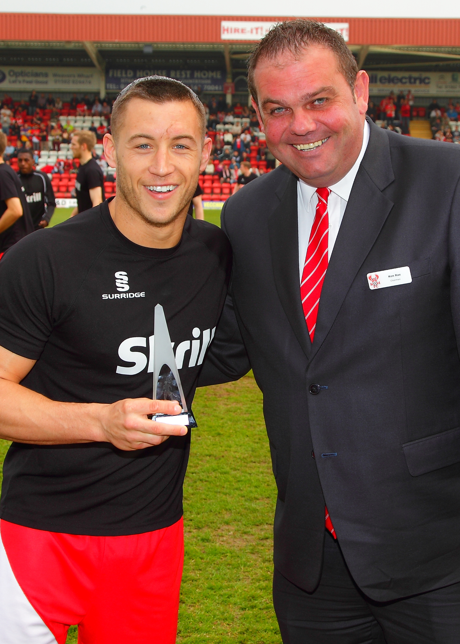 Harriers chairman Ken Rae (right) with last season's player of the year Lee Vaughan.