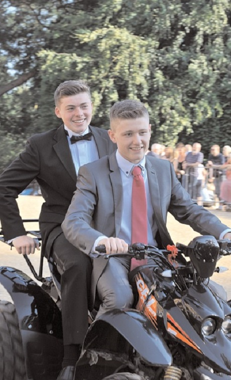 DEVASTATED: Oliver Green, front, rocks up with a friend to his high school prom last year on the quad bike, which has been stolen.