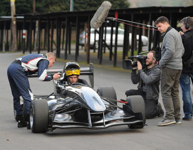SPEED RACERS: Guy Martin in the car, takes advice from Scott Moran as filming takes place.