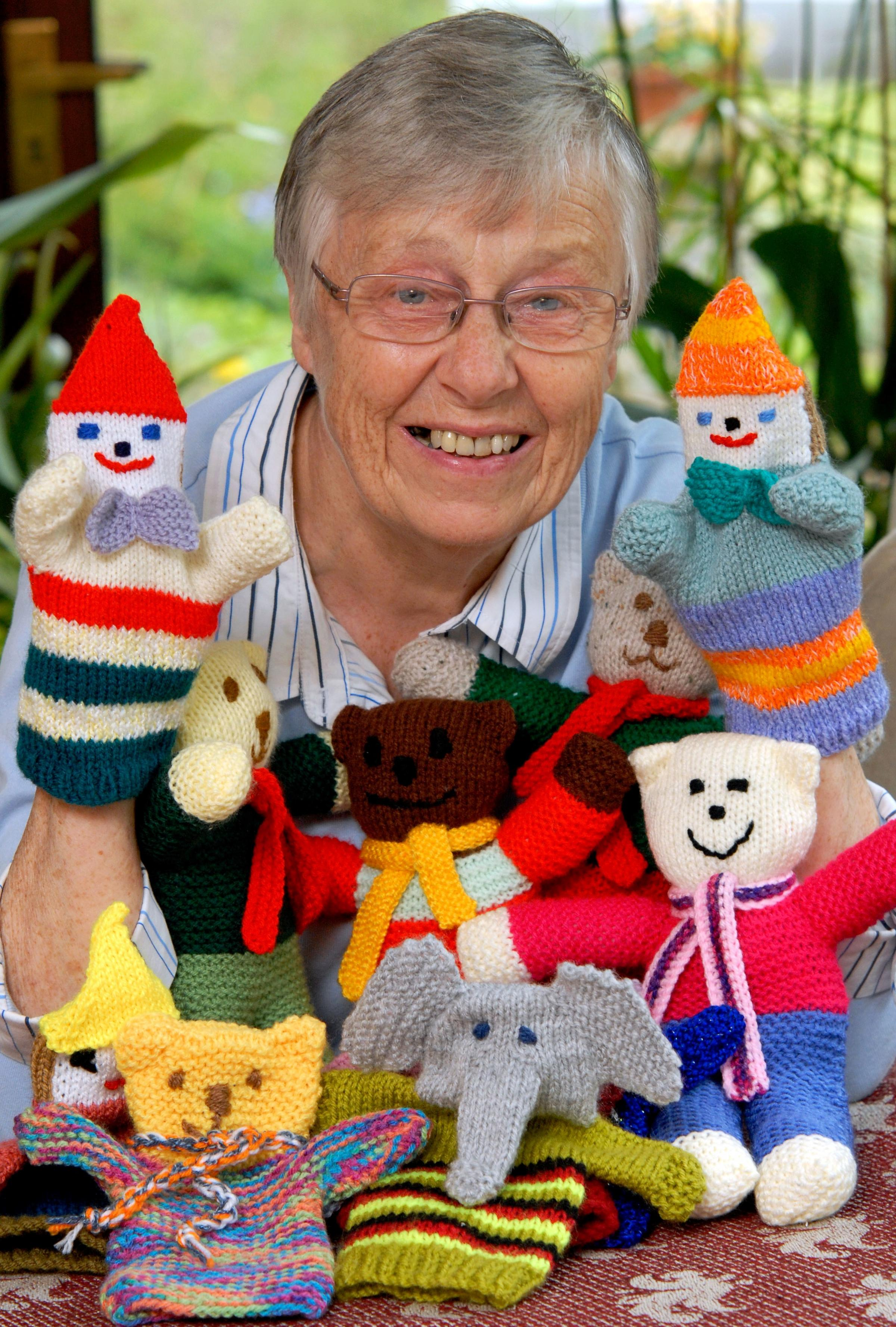 KNITTED FRIENDS: Teddies for Tragedies organiser Chris Doncaster with some of the items donated to her to send to children suffering in war-torn and poor countries. Picture: Phil Loach. 171418L.