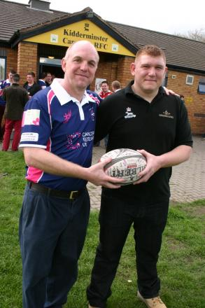 WORTH A TRY: Neil Evans receives the match ball signed by all the players from Kidderminster captain Matt Bingham.