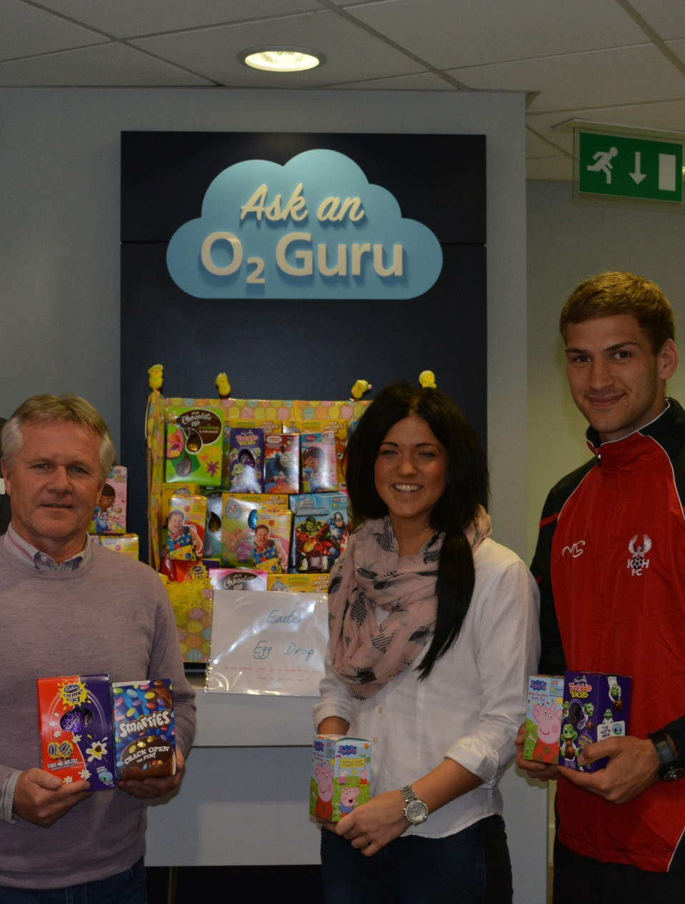 FOODBANK HELP: From left, Gary Whild, Harriers marketing assistant Harriet Cook and Mickey Demetrious pick up the Easter eggs.