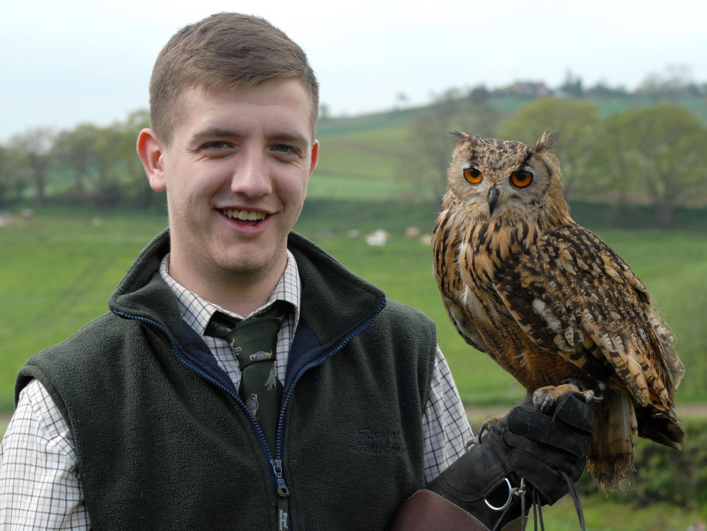 FLIGHT OF FANCY: Matthew Harvey with Boo the Bengal eagle owl, one of his birds of prey.