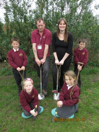 GREEN-FINGERED: Rachel Cockayne of Worcestershire County Council and outdoor learning manager Mick Lees with St Bartholomew's children cutting the sod using their new tools.