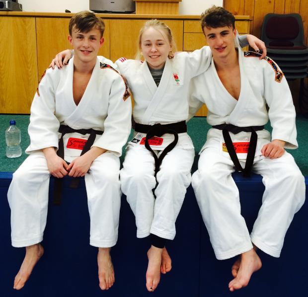 New black belts: Samurai Judo Club youngsters Frankie Marsden with Rory and Arran Gulliver show off their new black belts.