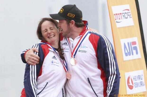 Kiss success: Naomi Folkard gets a kiss from partner Larry Godfrey after they won bronze at the Archery World Cup in Shanghai.