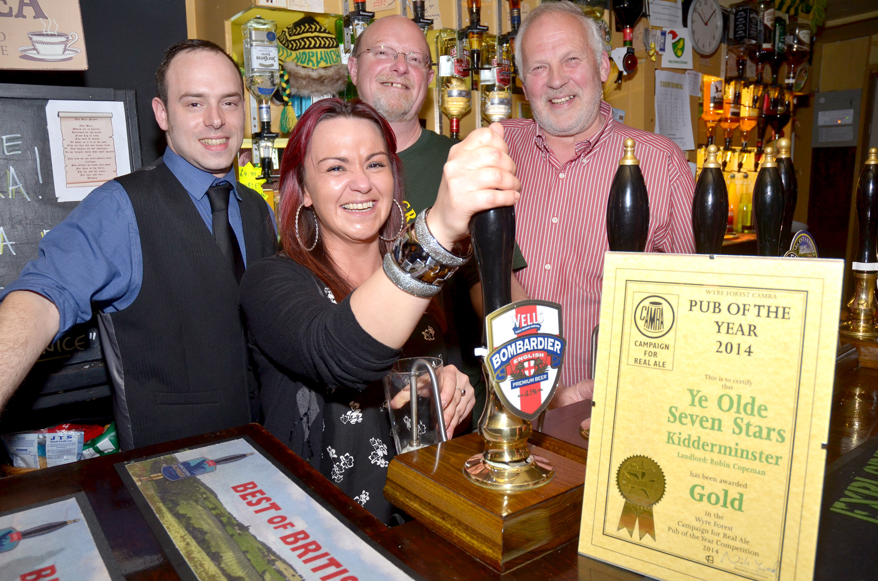 TOASTING SUCCESS: From left, staff Laurence Goodwin, Lois Cooksley, CAMRA chairman Nick Yarwood and landlord Robin Copeman. Photo: COLIN HILL.