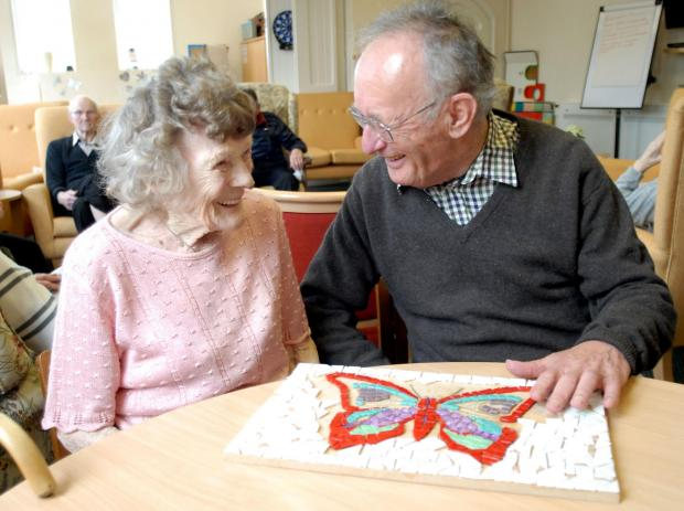 BUTTERFLY EFFECT:  Among Friends clients Edith Marshall and Frank Lancaster with the mosaic.