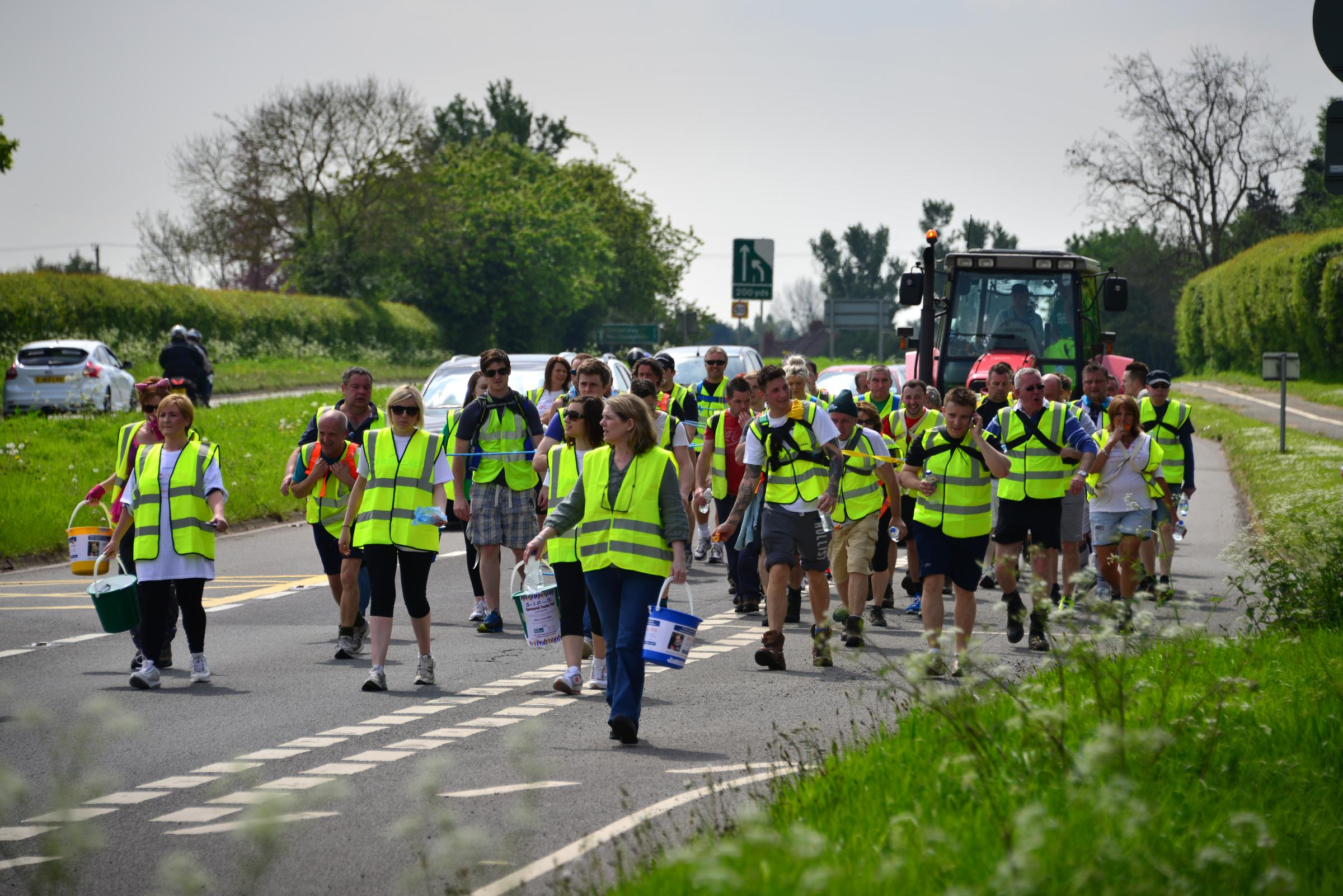 ON THE PULL: Members of the Station Inn, Kidderminster, pull the 5.5 tonne tractor down the A449 between Droitwich and Kidderminster.