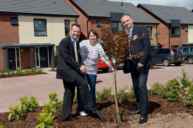 Kidderminster Shuttle: PUTTING DOWN ROOTS: From left, David Gough, Jenny Kimber and Richard Grounds plant a tree.