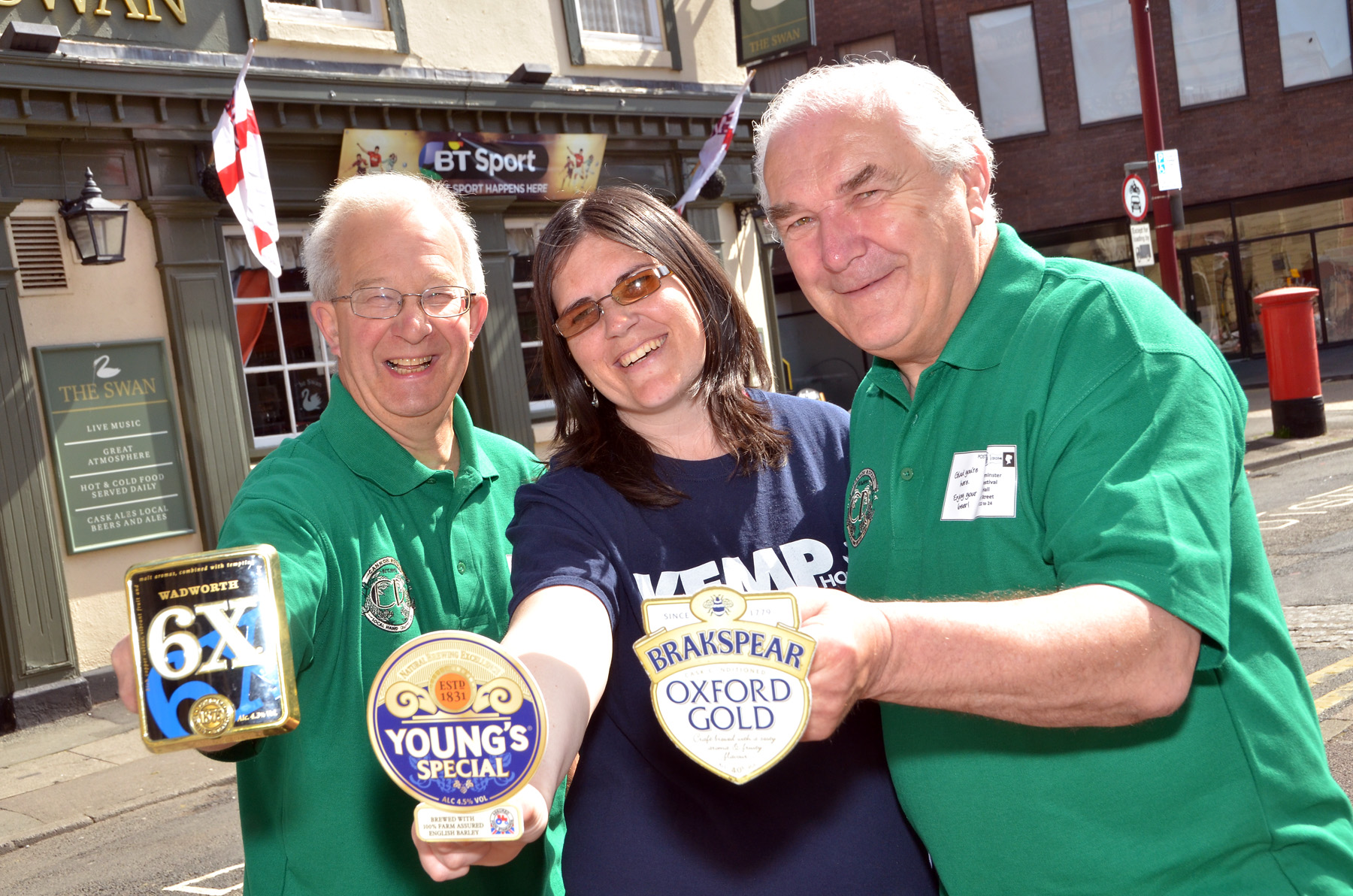FUNDRAISERS: Phil Wright and Pete Doncaster of Wyre Forest CAMRA with Debbie Broomfield of Kemp Hospice with pump clips that will be sold to raise funds. Photo COLIN HILL.