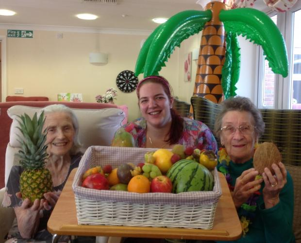 NEW TASTE: From left, resident Christine Newton, care assistant Ashleigh Davis and resident Joyce Harrison with their exotic fruit.