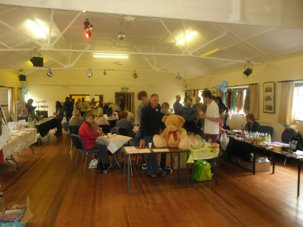 FUNDRAISERS: Visitors and stalls at the event in Clows Top Village Hall raising money for Vasculitis UK.
