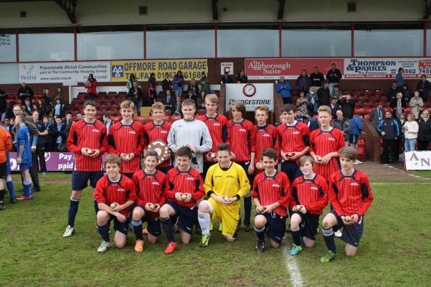 COUNTY CHAMPS: King Charles School's Under-14s boys side show off their medals at Aggborough.
