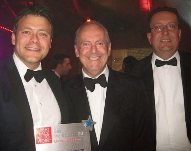 WORKING IT: Broadcaster Gyles Brandreth, centre, with Consilium Group staff Russell Tuck, left and Adrian Elwell