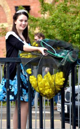 On your marks: Carnival Queen Jessica Campbell prepares to launch the duck race. Picture: Colin Hill.