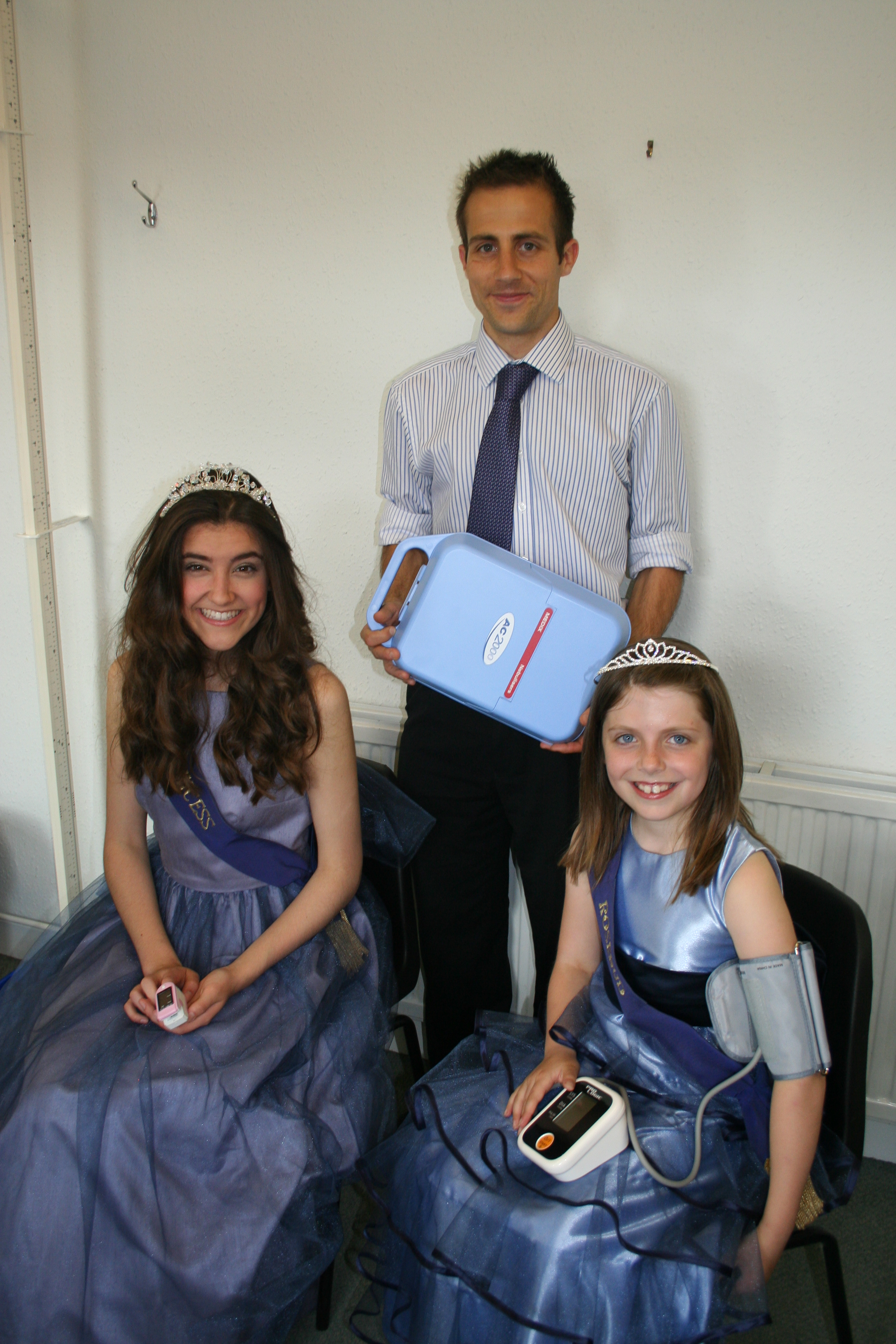 HELPING HAND: Dr Seb Morton from York House, with princess Aeron Holmes, left and rosebud Isobel Guise. Picture: Adrian Chase.
