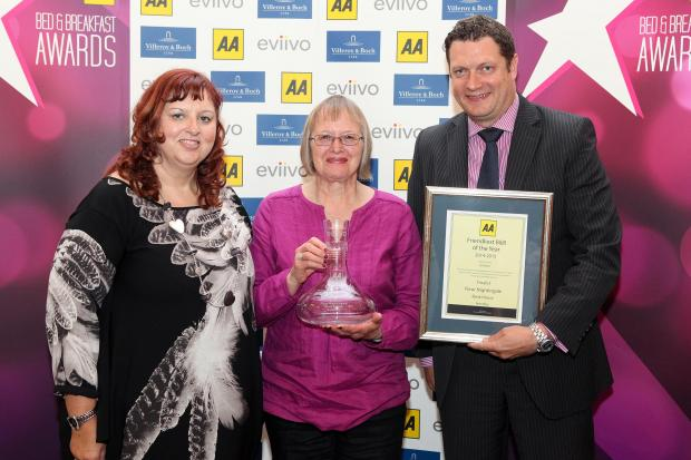 GOOD SERVICE: Fleur Nightingale, centre, receives her award and certificate from AA staff members Giovanna Grossi, left and Mark Cruston of sponsors Evivvo.