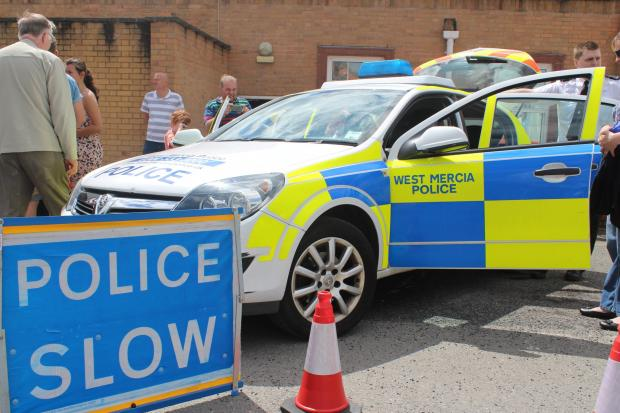 'ELLO, 'ELLO, 'ELLO: Residents check out a police car at a force open day in Kidderminster. Picture: West Mercia Police.