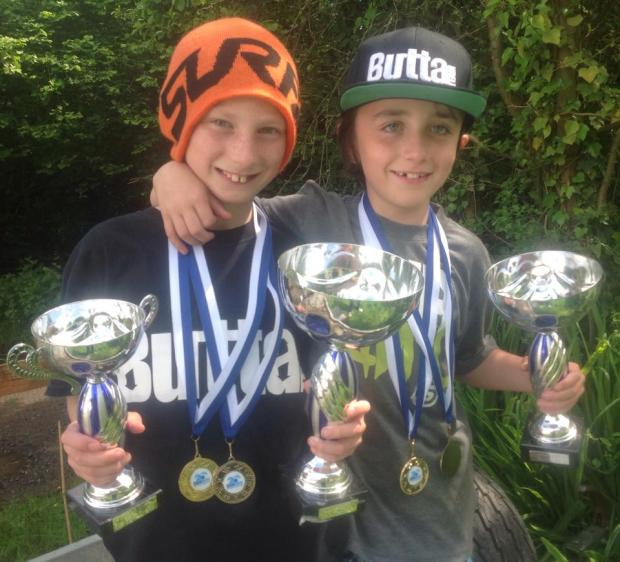 Downhill siblings are on the up: Sam and Tom Annis show off their silverware.