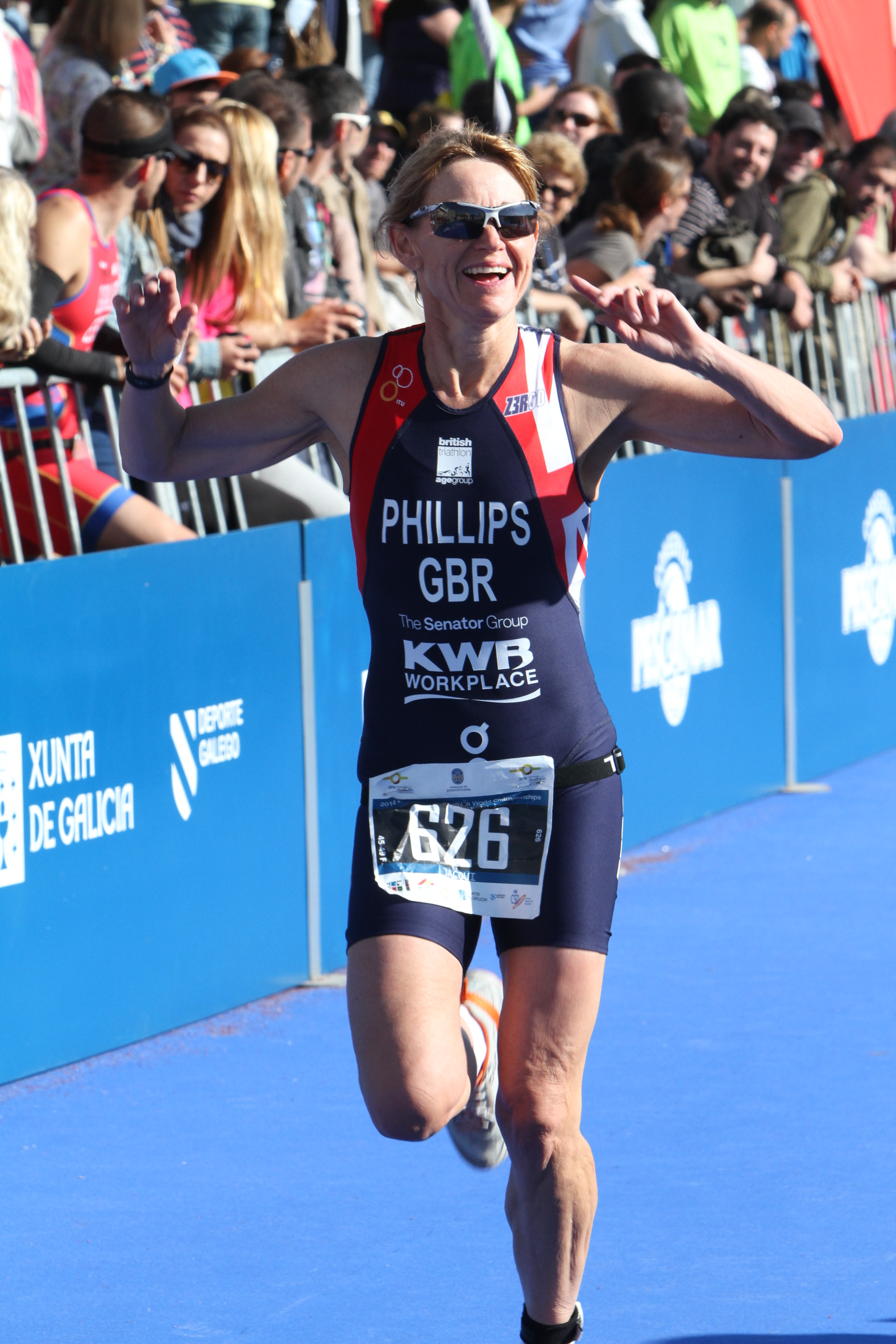 Smiling to success: Jacqui Phillips crosses the finishing line in Spain at the World Duathlon Championships.