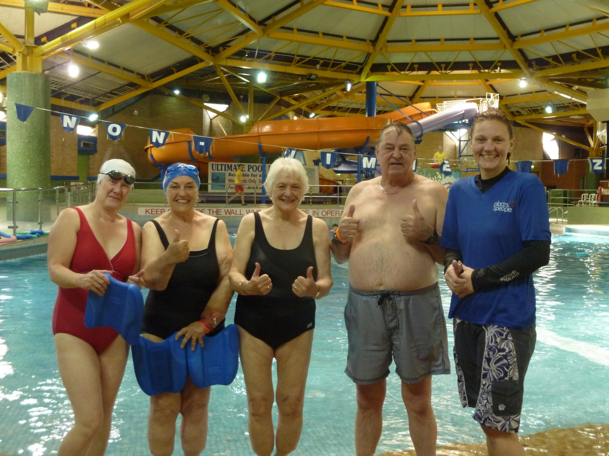MAKING A SPLASH: Keen swimmers, from left, Julie Byford, Meg Kent, Anne Hingley, Trevor Edwards and Vanessa Babbington at the Glades Leisure Centre.