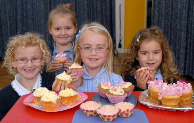 SUMMER FETE: Pupils of Burlish Park Primary School prepare for the baking competition.