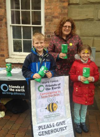BEE FUNDRAISER: Kay Ostle and her children, Jimmy (10) and Lizzie (7), fundraising for Wyre Forest Friends of the Earth.