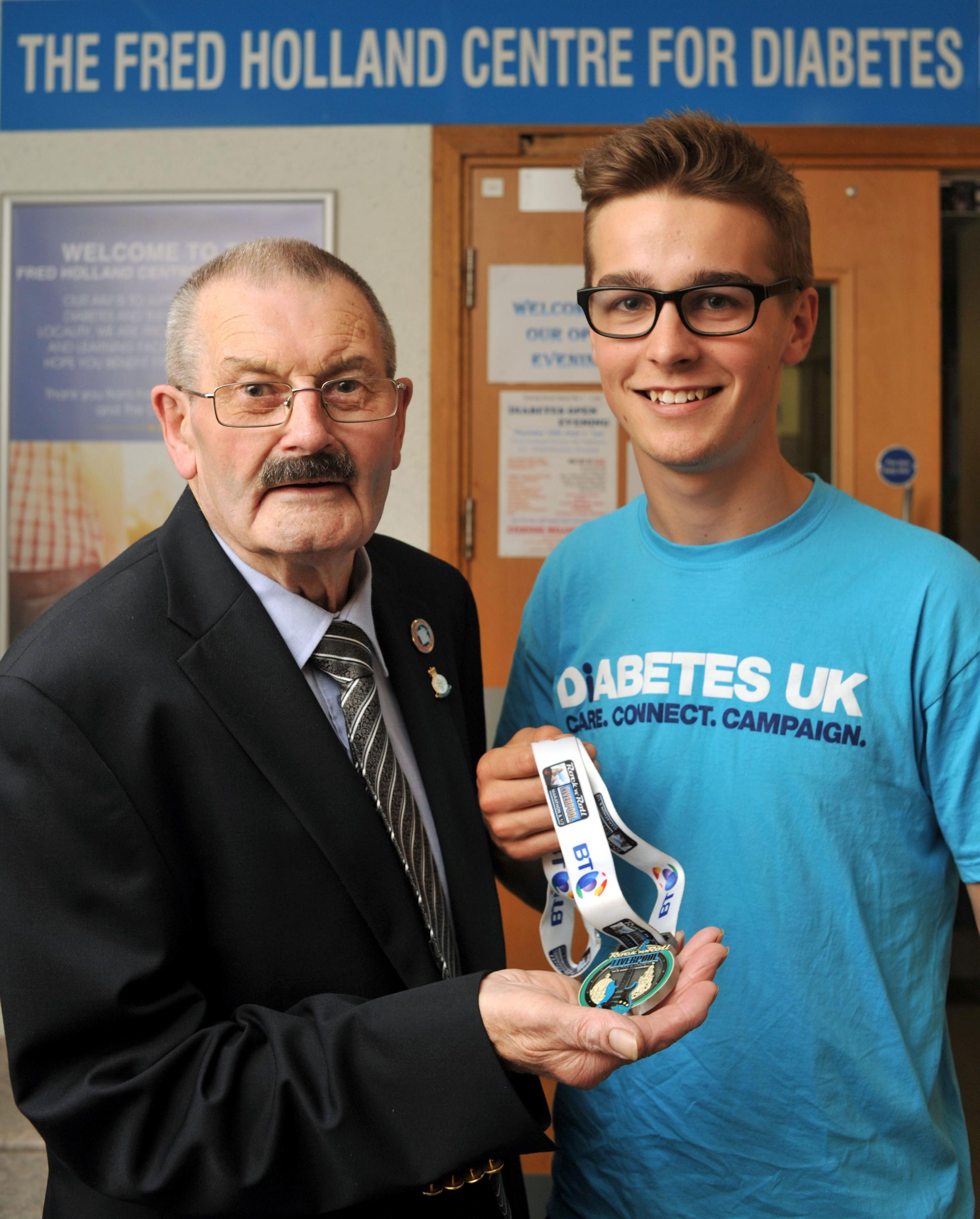 DONATION: Adam Stock with Diabetes UK Wyre Forest's Fred Holland. Picture: Phil Loach. 251408L.