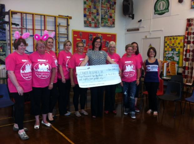 FITNESS FUNDRAISER: Claire Wier, who ran the London Marathon, and her Slimming World members who completed a five kilometre walk.