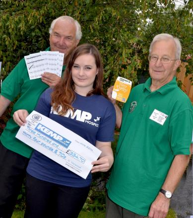 BEER MONEY: Phil Wright and Pete Doncaster of Wyre Forest CAMRA with Alice McMahon in the hospice gardens at Mason Road, Kidderminster. Photo Colin Hill.