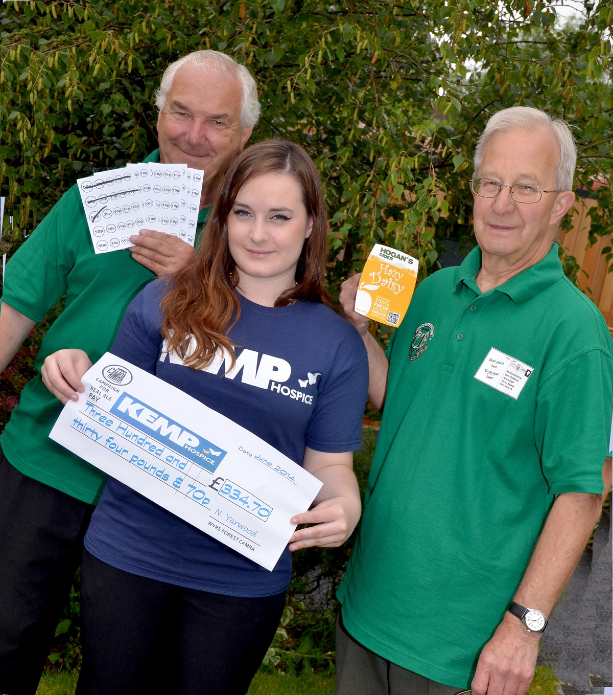 BEER MONEY: Phil Wright and Pete Doncaster of Wyre Forest CAMRA with Alice McMahon in the hospice gardens at Ma