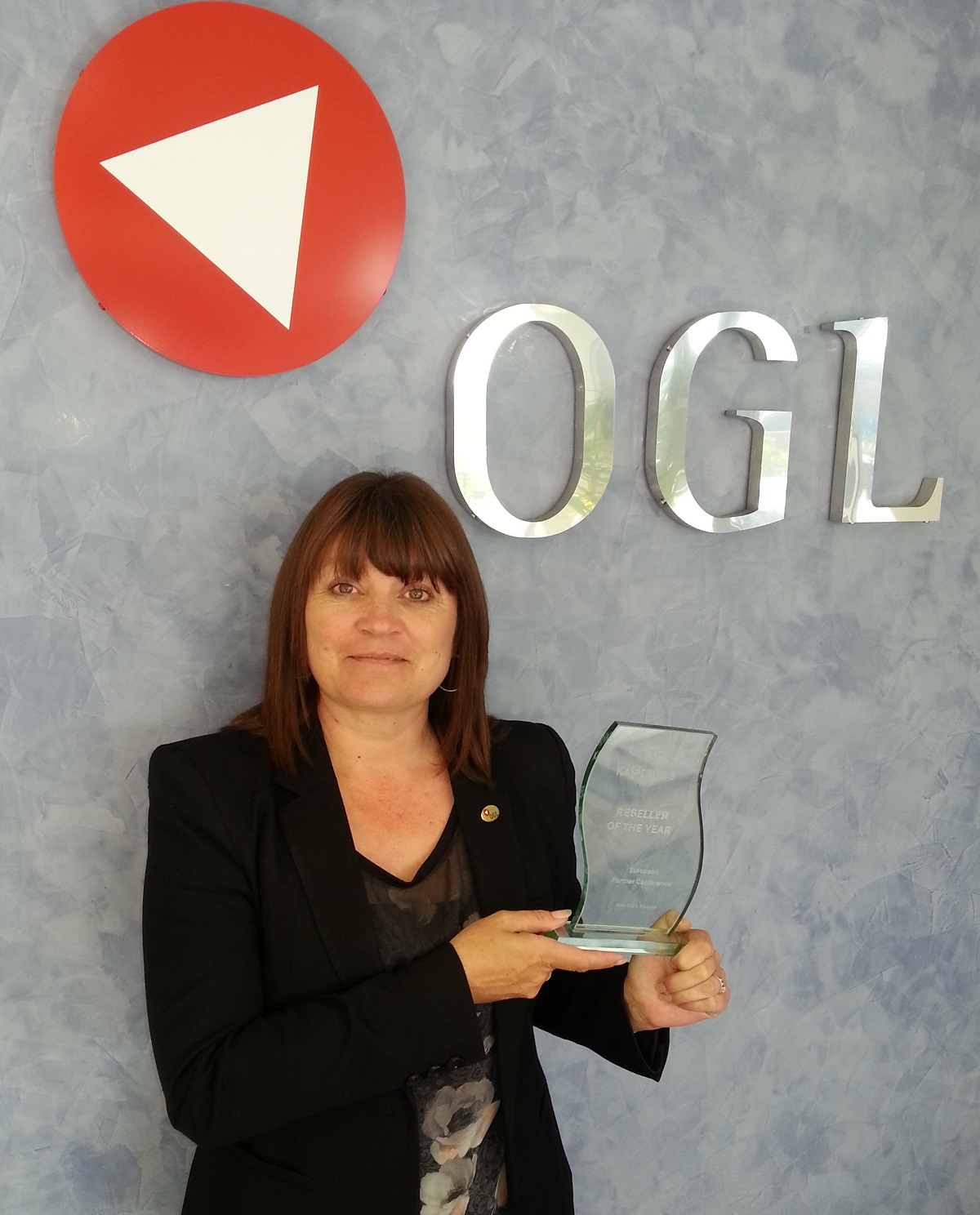 RUSSIAN RECOGNITION: Angela Bourne, OGL planned services manager, with the Kaspersky Reseller of the Year award 2014.