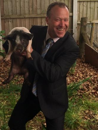 NATURE PROJECT: Headteacher Bryn Thomas with his namesake Bryn the piglet.