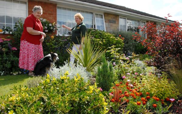 OPEN GARDEN: Sue Cook, right, one of 12 people who opened their gardens to the public, with her sister