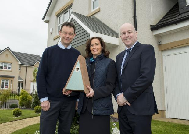 HOMING BIRDS: From left, Duncan Orr-Ewing, RSPB, Lynne Anderson, sales adviser, Miller Homes and Garry McDonald, procurement and sustainability director, Miller Homes.