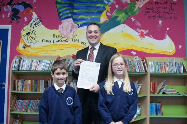 SUCCESS: Headteacher Joel Marshall,centre, celebrates with pupils Lewis DeCruze-Smith and Megan Hawthorne.
