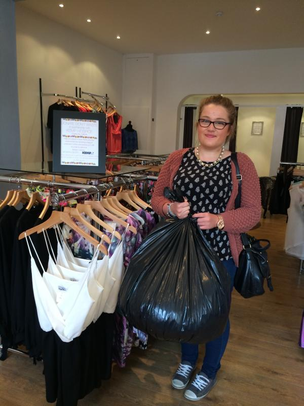 DONATIONS: Customer Melissa Price with her donated bag of clothes.
